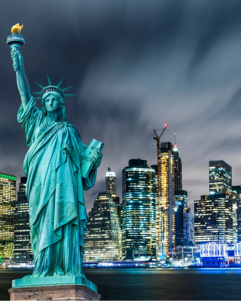 Statue of Liberty with New York City in the background.